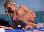 Hot blonde woman taking sun bath totlaly nude on the beach and it is possible to see her beautiful pussy very well - voyeur porn