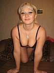 Cute blonde undressing and showing her great body in various positions on the bed, enjoy her lovely puffy vagina