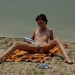 See the exciting pussies between wide spreaded legs of hot women sunbathing outdoors